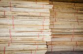 pic of lumber  - the Building supplies Stacked wood fence lumber - JPG