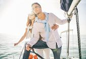 Постер, плакат: Couple Sailing On Boat
