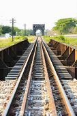 stock photo of tree lined street  - Railway line passing through the green plants - JPG