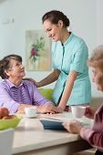 picture of nursing  - Young nurse taking care of elderly women - JPG