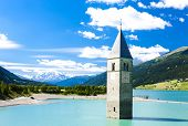 stock photo of south tyrol  - tower of sunken church in Resia lake - JPG