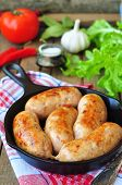 image of fried chicken  - fried chicken sausages with vegetables on a frying pan - JPG