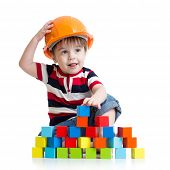 picture of hard_hat  - little child boy with hard hat and building blocks - JPG