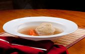 stock photo of penicillin  - home made matzoh ball soup with carrots and chicken - JPG