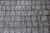 stock photo of cobblestone  - old mottled granite surface from cobblestone as a background - JPG