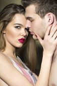 stock photo of lovers  - Sexual burning lovers embraces - JPG