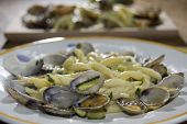 stock photo of clam  - pasta with veraci clams and fried zucchini