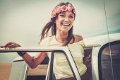 foto of hippy  - Hippie girl in a van on a road trip - JPG