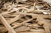 picture of lumber  - Pile of old and dirty lumber in construction site - JPG