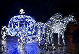 stock photo of carriage horse  - Decorative carriage with horses decorated with lights - JPG