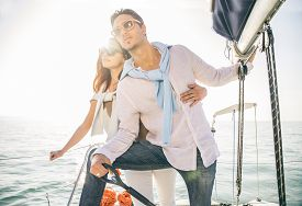picture of boat  - Beautiful couple of lovers sailing on a boat  - JPG