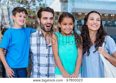 Happy family having fun in the mall on a bright day