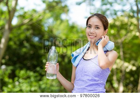 Sporty Woman hold with water bottle at outdoor after doing exercise