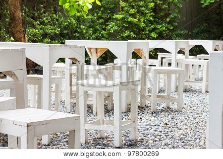 Row Of White Table And Chair In The Garden