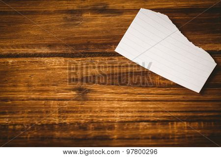 Scrap of paper on wooden table with copy space