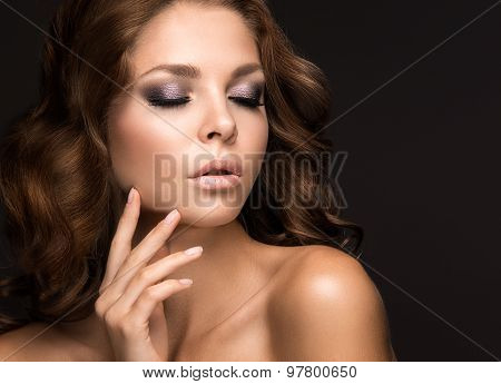 Beautiful woman with evening make-up and long straight hair . Smoky eyes. Fashion photo