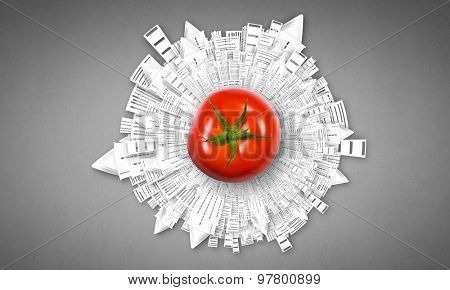 Tomato against white background with business sketches