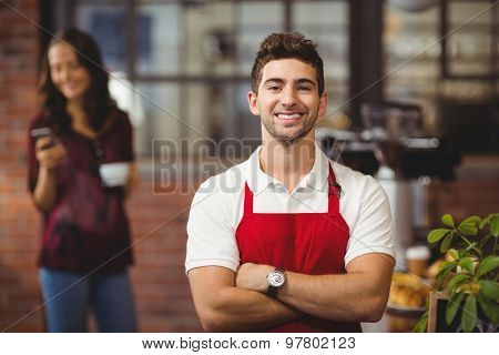 Portrait of a waiter with arms crossed at the coffee shop