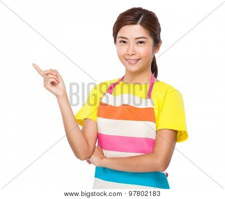 Young housewife with finger point up