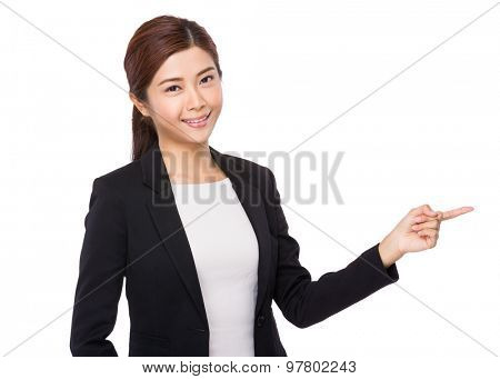 Asian businesswoman with finger point aside