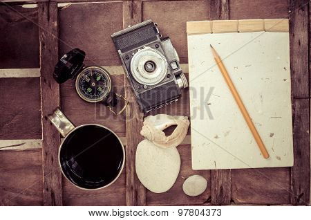 Cup Of Coffee With Compass Notepad And Camera