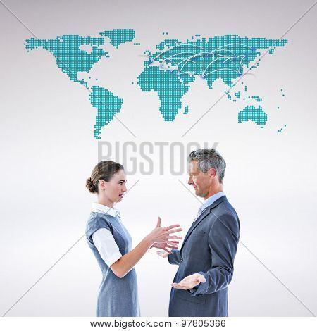 Business team arguing against world map