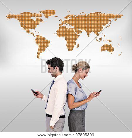 Business people using smartphone back to back against orange world map on white background