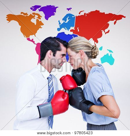 Business people wearing and boxing red gloves against grey background