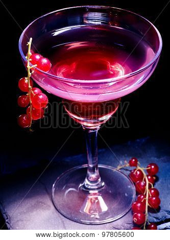 Pomegranate cocktail decoration red currant  branch  on black background. Cocktail card 71.