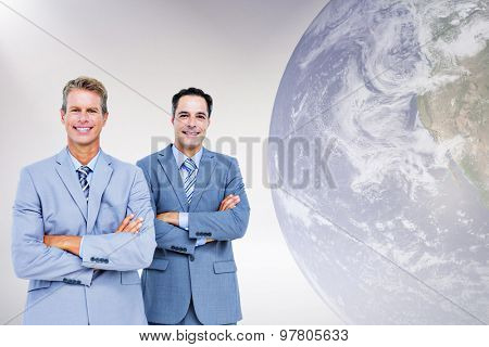 Business team standing arms crossed against grey background Business team standing arms crossed against a white screen