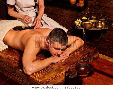 Man  having oil Ayurveda spa treatment.