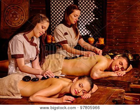 Couple  having stone Ayurveda spa treatment.