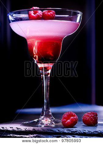 Pomegranate drink with raspberries on black background. Cocktail card  72