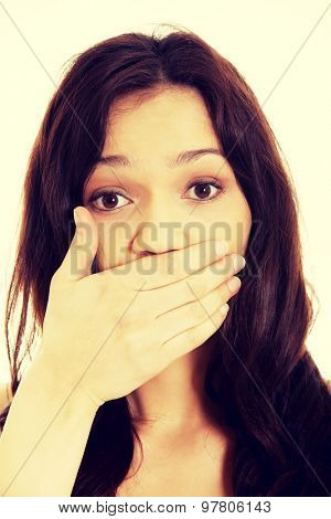Young shocked student woman covering her mouth.