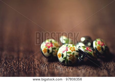 Vintage metal buttons with flowers on it