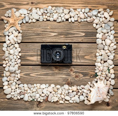 Frame from sea shells and stones