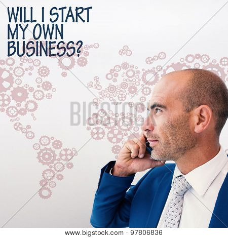 businessman calling on the phone against grey background