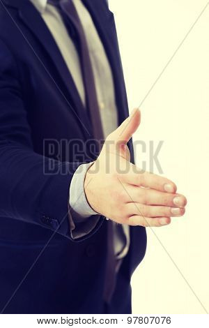 Young businessman giving a handshake.