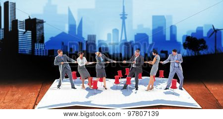 Business team pulling the rope against cityscape stencil design