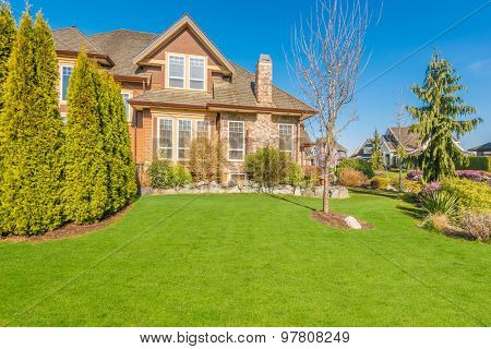 Luxury house with perfect green lawn in front yard in Vancouver, Canada.