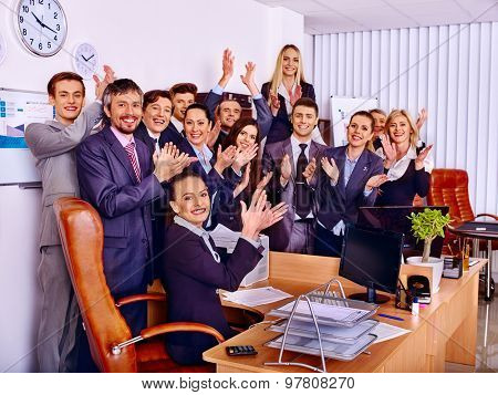 Happy group business people clap ones hands together in office.