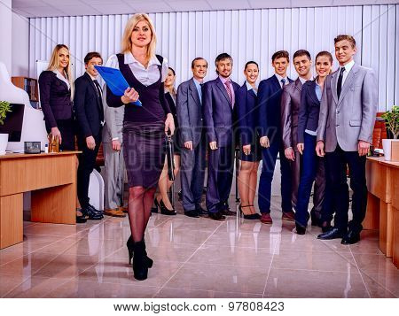Group business people in office. Woman on foreground.