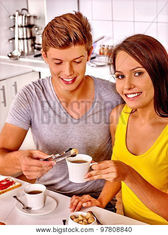 Happy nice loving couple breakfast at kitchen.