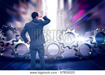 Businessman standing hand on hip against blurry new york street