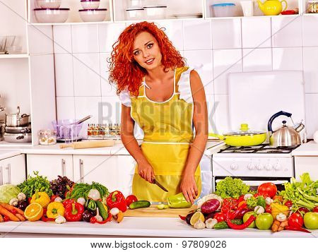 Happy woman cut vegetable and cooking breakfast at kitchen.