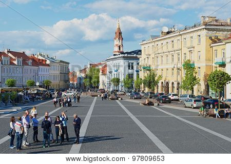 Tourists walk by the Town Hall square in Vilnius, Lithuania.