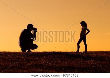 Father photographing his daughter