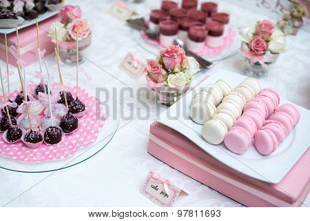 Colorful Wedding Candy Table with all the chocolate goodies on display.