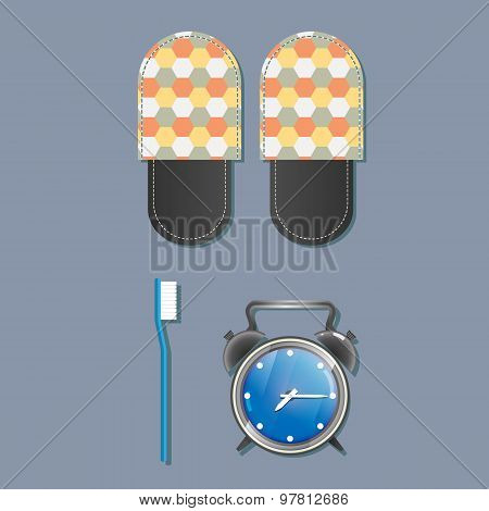 Slippers, alarm clock and toothbrush