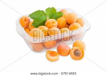 Ripe Apricots In Plastic Tray And Several Apricots Separately Closeup